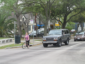 Cyclists and motorists share the road on Heights Blvd at 11th Street.